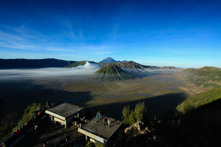 High angle view of volcanic landscape against blue sky