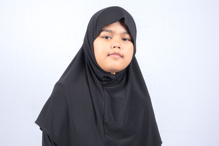 Portrait Of Girl Wearing Hijab Over White Background