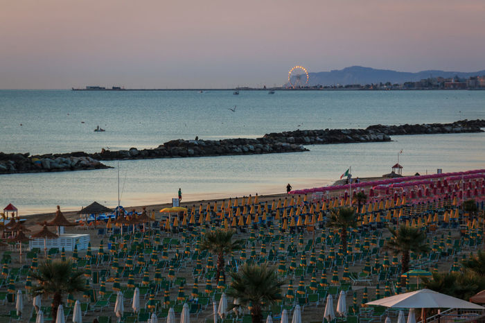 The morning on the beach of Torre Pedrera at Rimini in Italy Sea Water Sky Architecture Nature Built Structure Building Exterior High Angle View Horizon Sunset Land Scenics - Nature Beach Beauty In Nature Horizon Over Water Plant Day Outdoors Group Of People Beach Lounger Sunrise Adriatic Sea Torre Pedrera Seaside Resort Sunshade
