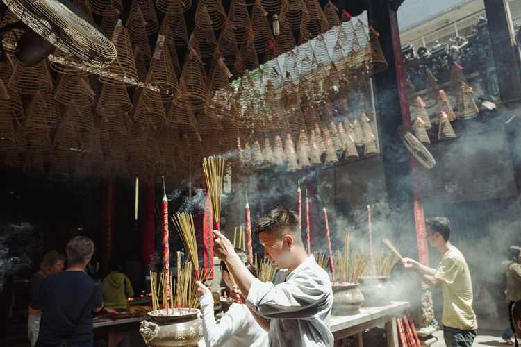 Shot at Thien Hau Temple, Saigon, Vietnam. Adult Day Food Freshness Hanging Indoors  Large Group Of People Men People Real People Religion Spirituality Togetherness Women