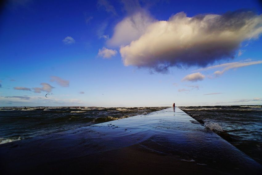 Sea Water Beach Sky One Person Cloud - Sky Travel Destinations Landscape Outdoors Horizon Over Water Vacations Nature Blue