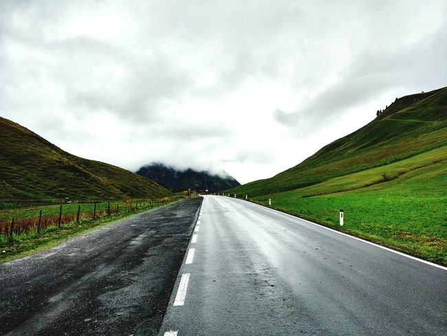 Road Landscape Nature Street Highway Cloud - Sky Journey Driving Scenics Travel Winding Road Outdoors Rural Scene Mountain No People Beauty In Nature Cyclone Tree Area Day Symmetry