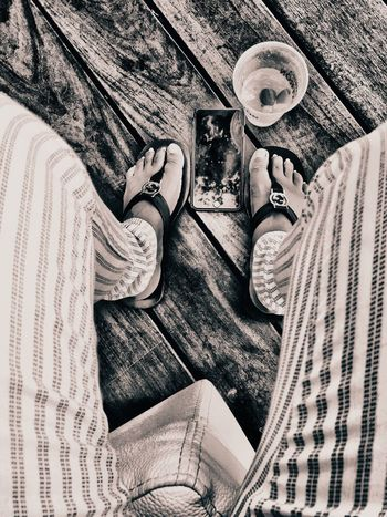 High Angle View Real People Day One Person Close-up Adult People Stripes Pattern Trousers Pants Flipflops GUCCI Fashion Style Cocktail IPhoneography Mobile Phone Seated Wood Floor Leisure Activity EyeEmNewHere