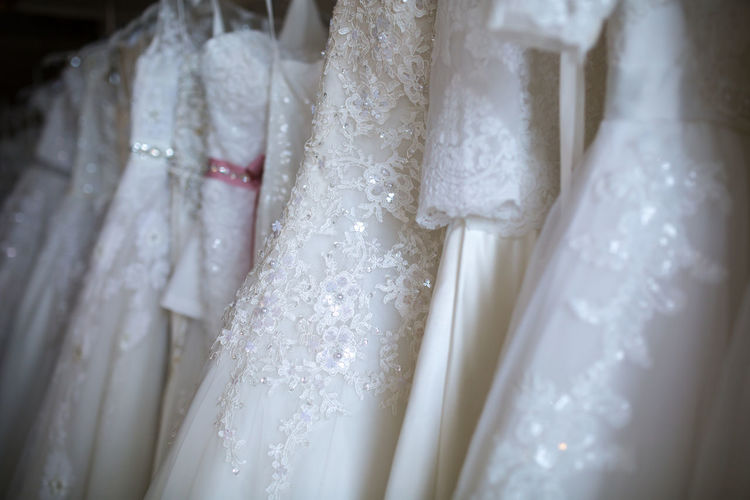 Close-Up Of Wedding Dresses In Bridal Shop