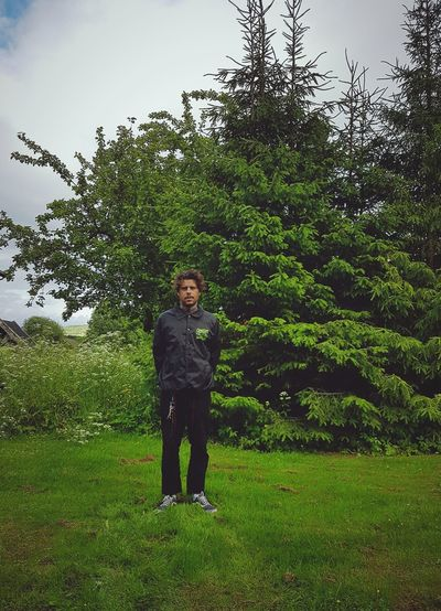 One Man Only One Person Full Length Standing Only Men Adults Only Adult Tree Green Color Front View People Grass Growth Outdoors Men Day Nature Sky