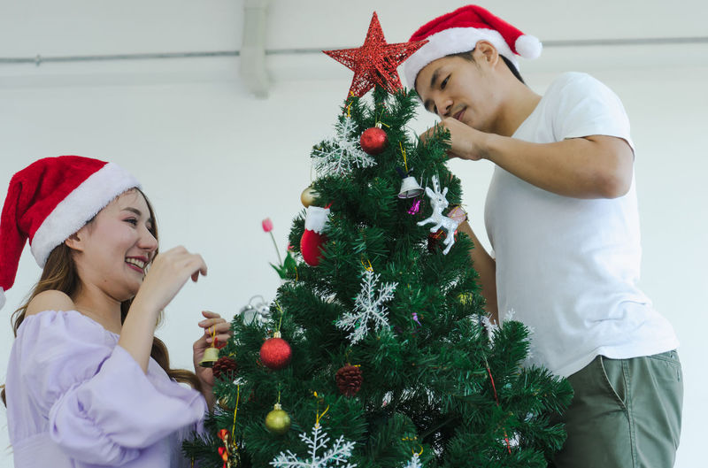 Female friends with christmas tree