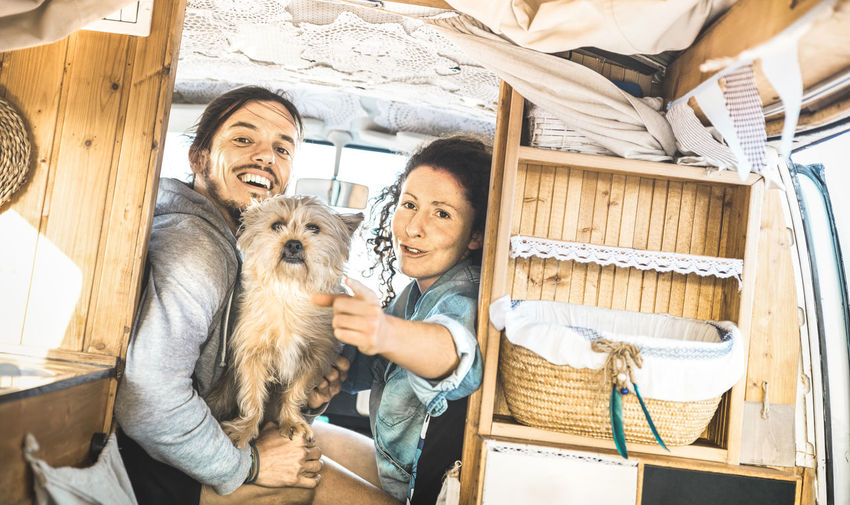 Portrait Of Happy Couple In Camper Van