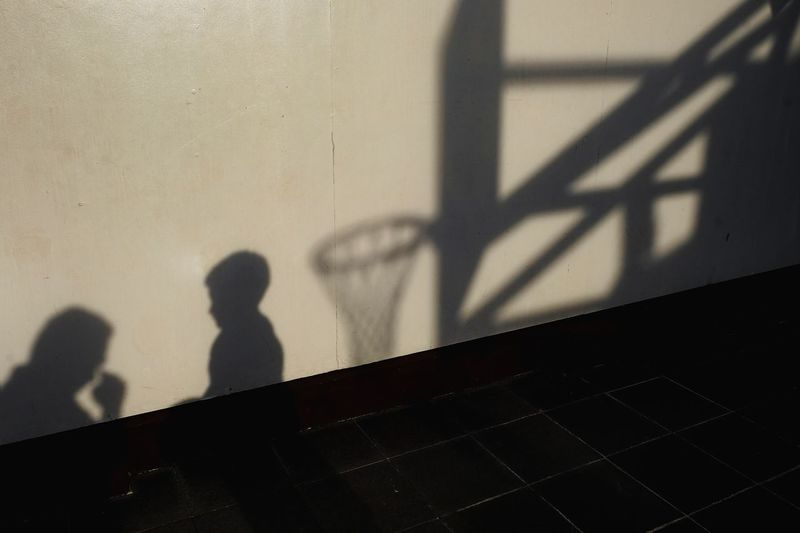EyeEm Best Shots EyeemPhilippines EyeEm Streetphotography Streetphoto_color Street Eyeemphotography Basketball Basketball - Sport Basketball Hoop Shadow Prison Shadow City Sunlight Silhouette Focus On Shadow Long Shadow - Shadow Street Scene 17.62° The Art Of Street Photography