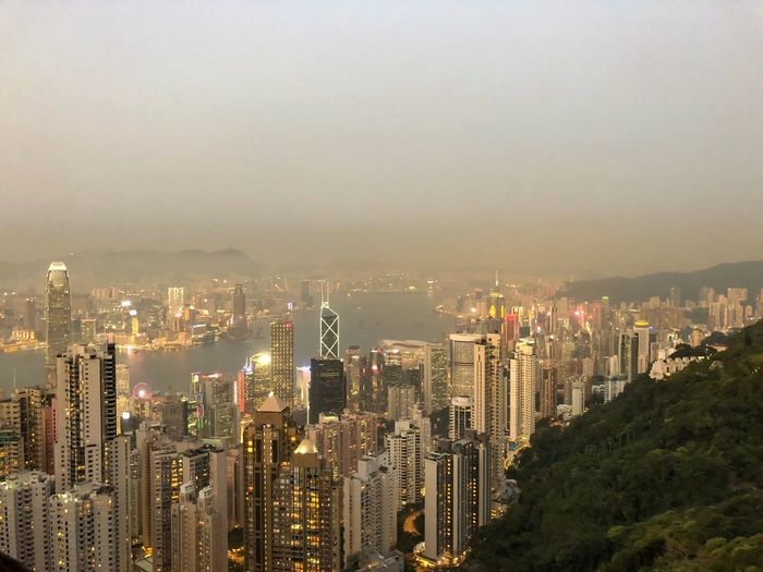 Hong Kong skyline at dusk from the Peak Peak Metropolis ASIA Harbor Victoria Skyline Hong Kong Dusk Sunset Cityscape Architecture City Skyscraper Building Exterior Crowded Modern Built Structure Illuminated Travel Destinations Outdoors Go Higher