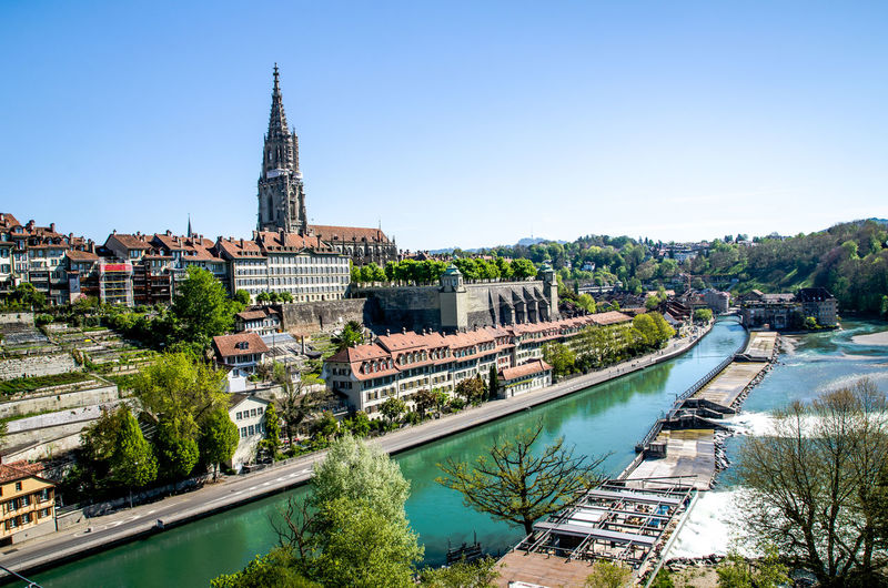 High Angle View Of Bern Minster By Aare River Against Clear Sky