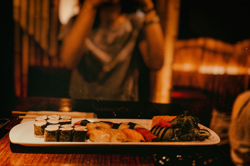 Sushi Adult Domestic Room Focus On Foreground Food Food And Drink Freshness Indoors  Japanese Food Lifestyles Midsection Occupation One Person Plate Ready-to-eat Real People Restaurant Standing Table Wellbeing Women HUAWEI Photo Award: After Dark HUAWEI Photo Award: After Dark