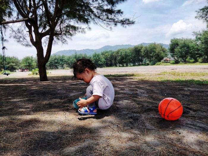 Girl playing with ball on field