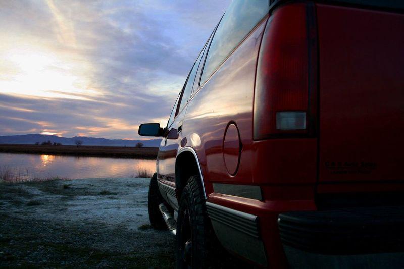 Chevy Tahoe Lake Long Drives Black Rims Red Tahoe