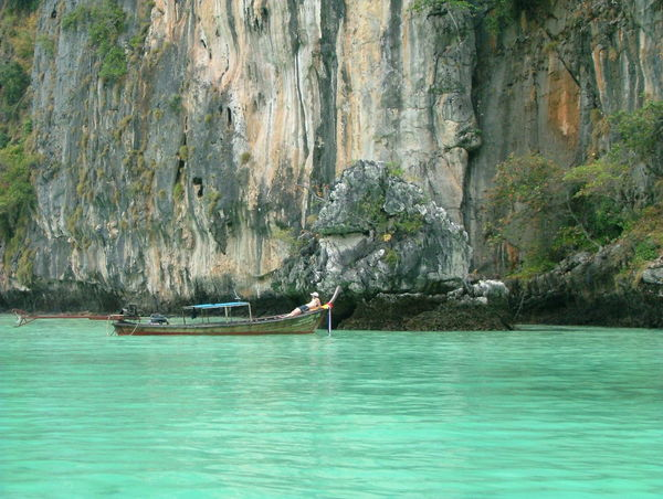 Aquamarine Blue Blue Boat. Cliff Colour Leisure Activity Lifestyles Men Mountain Nautical Vessel One Person. One Personality. One Heart Relaxing Resting Rock Formation Sailing. .. Scenics Sea Sea And Sky Spotted In Thailand Tranquil Scene Tranquility Vacations Water