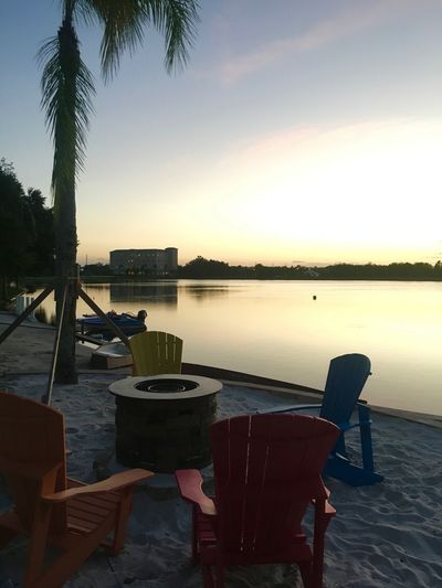 Beach Time Orlando Water Reflections Beach Beauty In Nature Chair Chairs Evening Horizon Over Water Lake Nature Nautical Vessel No People Outdoors Palm Tree Scenics Sea Silhouette Sky Sunset Table Tranquil Scene Tranquility Water