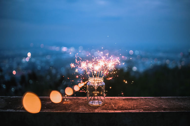 Close-Up Of Sparklers In Jar At Night