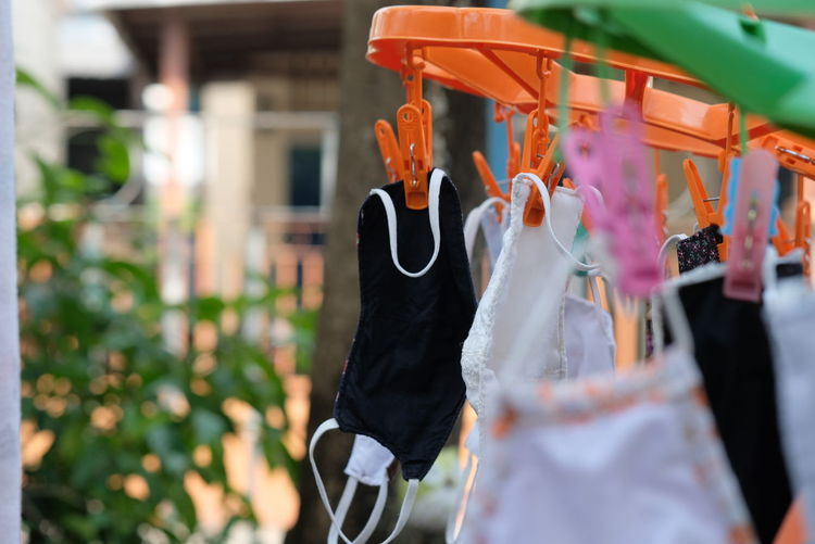 Close-up of clothes hanging on clothesline at store
