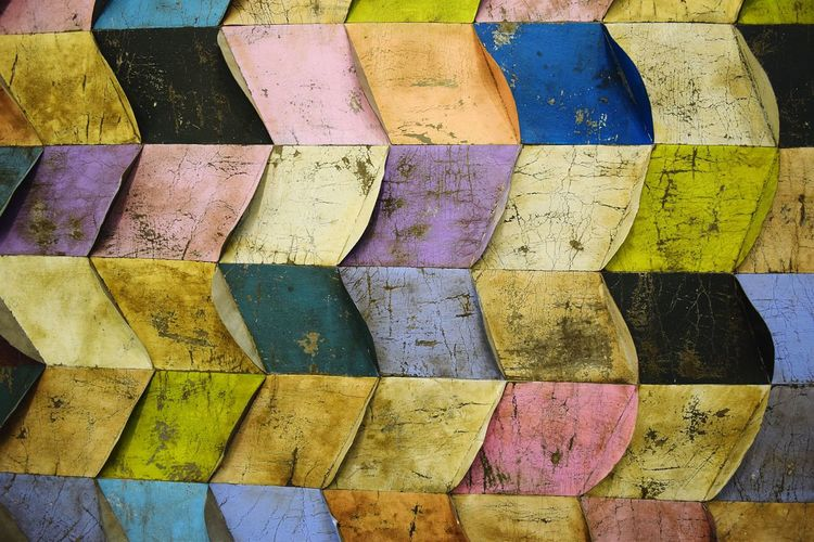 Full frame shot of textured colorful wall
