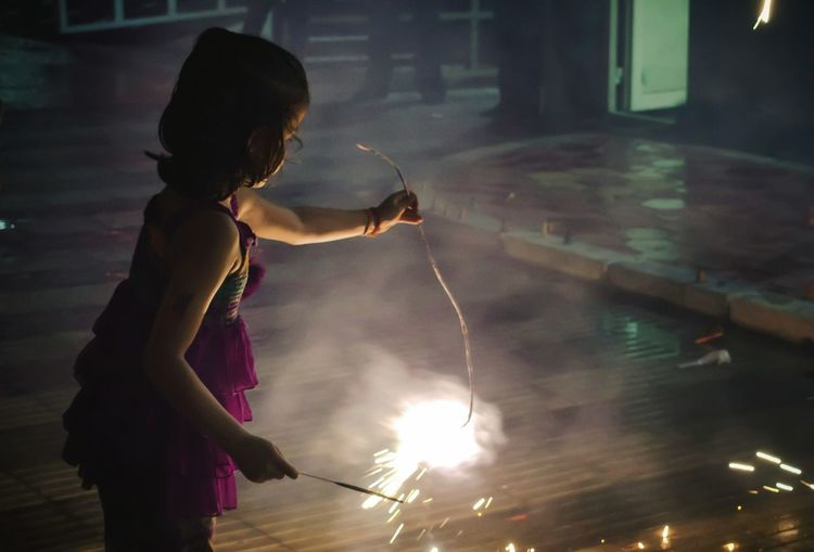 Girl Playing With Burning Sparkler