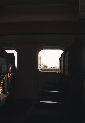 Dark Emotions Japan Shadows & Lights Architecture Indoors  Journey Land Vehicle Mode Of Transportation Nature negative space Public Transportation Rail Transportation Seat Sunlight Train Train - Vehicle Transportation Travel Vehicle Interior Vehicle Seat Warm Warm Light Window