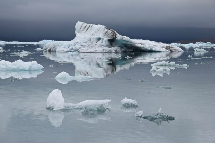 Scenic View Of Glaciers On Lagoon Against Sky