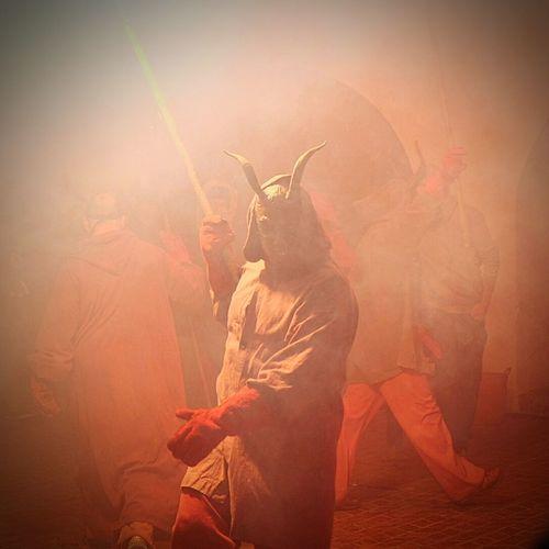 Man In Demon Mask On Street