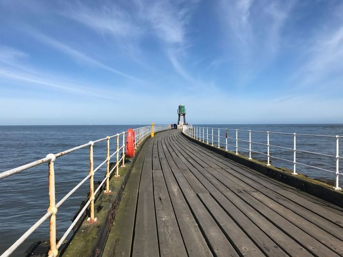 EyeEm Selects Railing Sea Pier Water Sky Horizon Over Water Wood - Material Wood Paneling Tranquil Scene Jetty Tranquility Day Scenics Beauty In Nature Cloud - Sky Nature Outdoors Blue Sunlight Built Structure