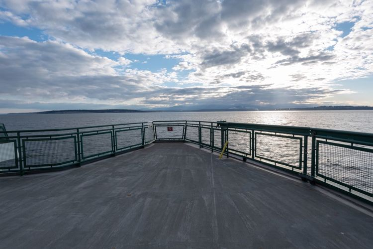 Landscape of water and clouds from a ferry in the Puget Sound Boat Deck Ocean Ferry Ride Ferry Boat Washington State Port Townsend Ferry Cloud - Sky Water Sky Sea Railing Nature The Way Forward Horizon No People Outdoors Tranquil Scene Connection Beauty In Nature Tranquility Direction Scenics - Nature Horizon Over Water