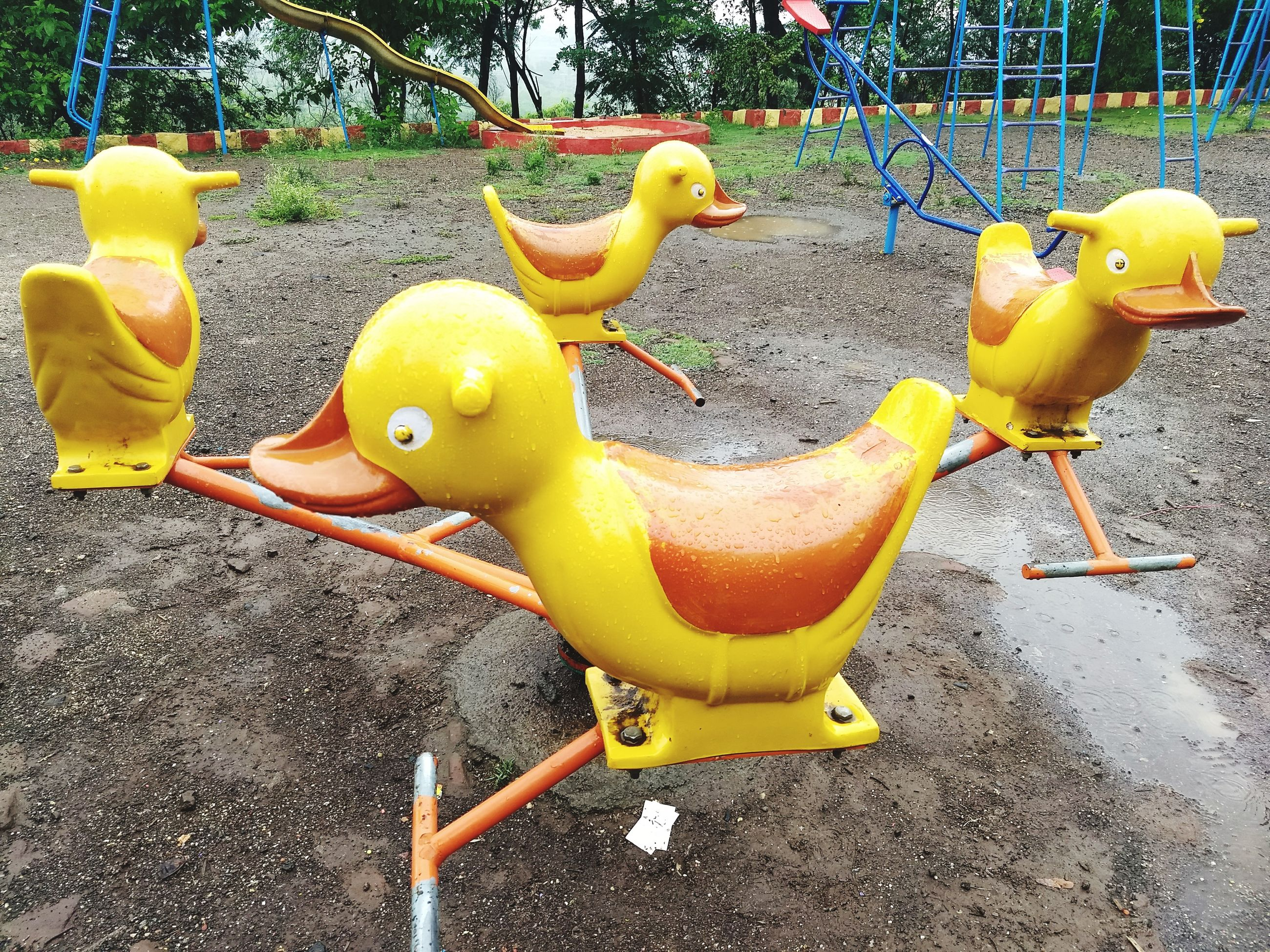yellow, childhood, animal representation, no people, playground, day, outdoors, outdoor play equipment, close-up