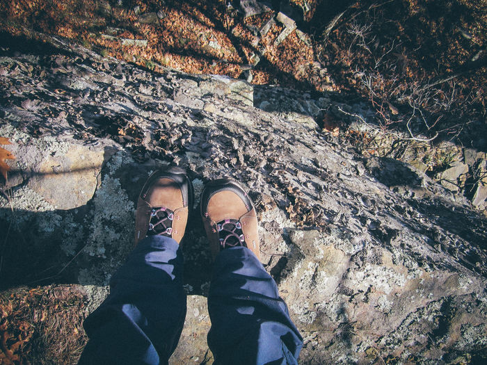 Adult Boots Cliff Day Edge High Angle View Hike Hiking Human Body Part Human Leg Leisure Activity Lifestyles Low Section Men Nature Nature Outdoors People Personal Perspective Rock Shoe Standing