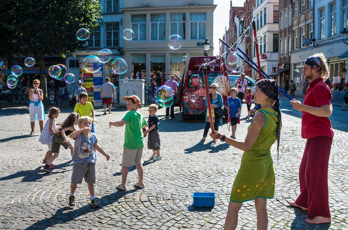 Street City Life City Street Large Group Of People Performance brugge Young Women Young Adult Arts Culture And Entertainment Soap Belgium. Belgique. Belgie. Belgien. Etc.