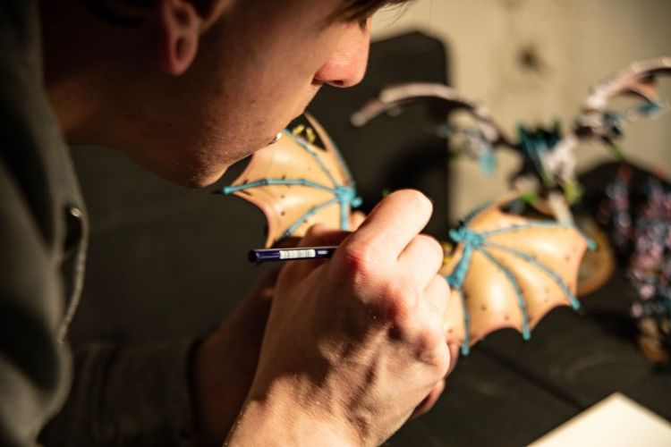 High angle view of man making decorating equipment in halloween