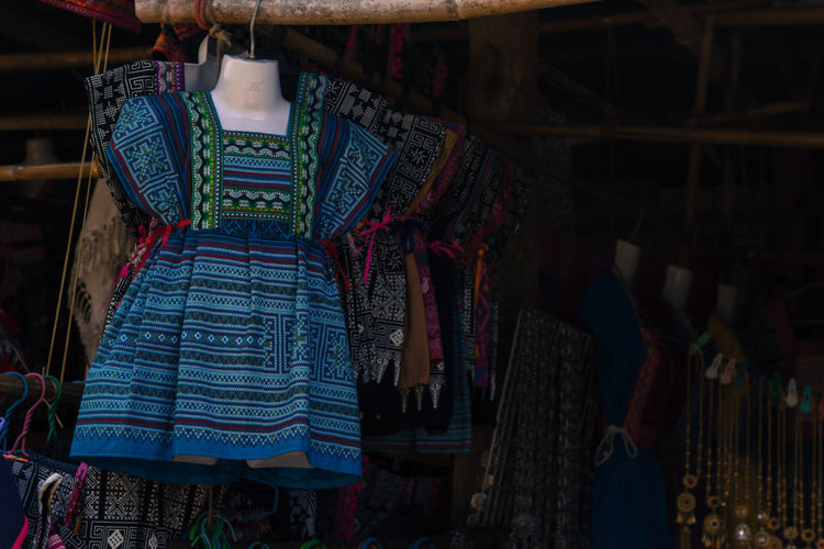 Clothes hanging in store for sale in market