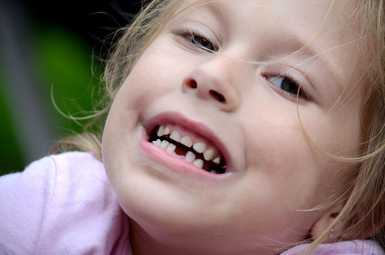 A little girl shows off her first missing tooth Female Blond Hair Body Part Caucasian Child Childhood Close-up Cute Emotion Females Girls Hair Headshot Human Body Part Human Face Human Teeth Innocence Kid Missing Tooth Mouth Mouth Open Offspring One Person Portrait Real People The Portraitist - 2018 EyeEm Awards