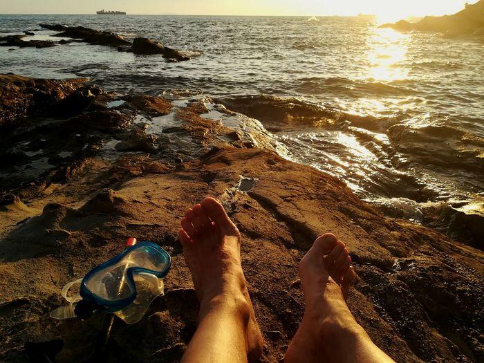 Livorno. Tuscany.sea Relaxing Low Section Water Sea Beach Men Human Leg Sunset Sunlight barefoot Sand Pebble Beach Ocean Shore Human Foot Horizon Over Water Rushing Sandy Beach Sole Of Foot Human Toe Toenail Seaside Feet Wave Calm Driftwood