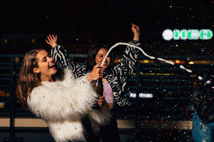 Smiling young women enjoying in night club