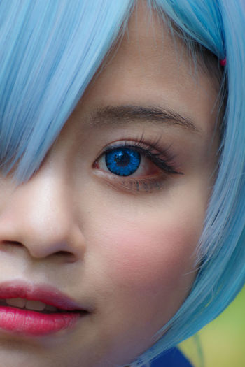 Close-up of beautiful woman with blue eyes