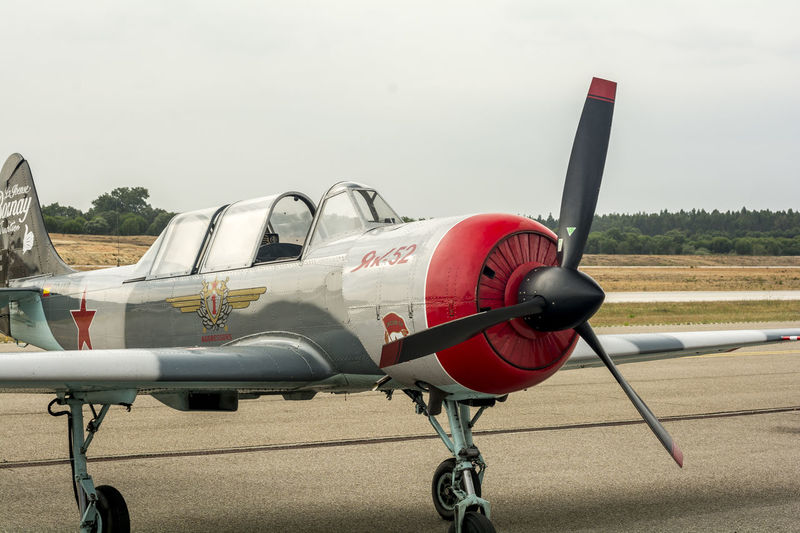 Air show with Yak-52 aircraft in Portugal Aerospace Industry Air Vehicle Airplane Airport Runway Close-up Day Helicopter Model Airplane No People Outdoors Propeller Airplane Red Sky Transportation Weapon