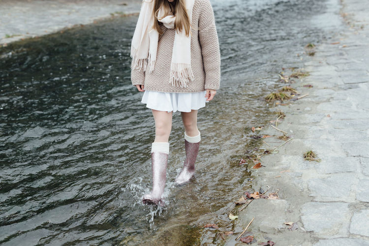 Woman standing in water