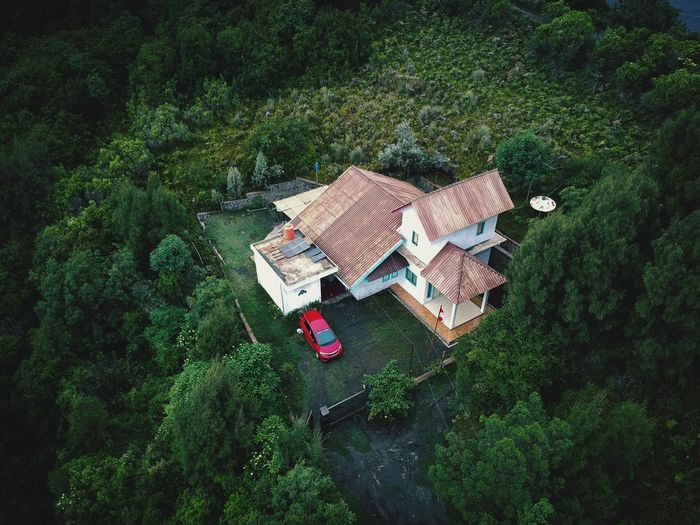 High angle view of cottage amidst trees in forest