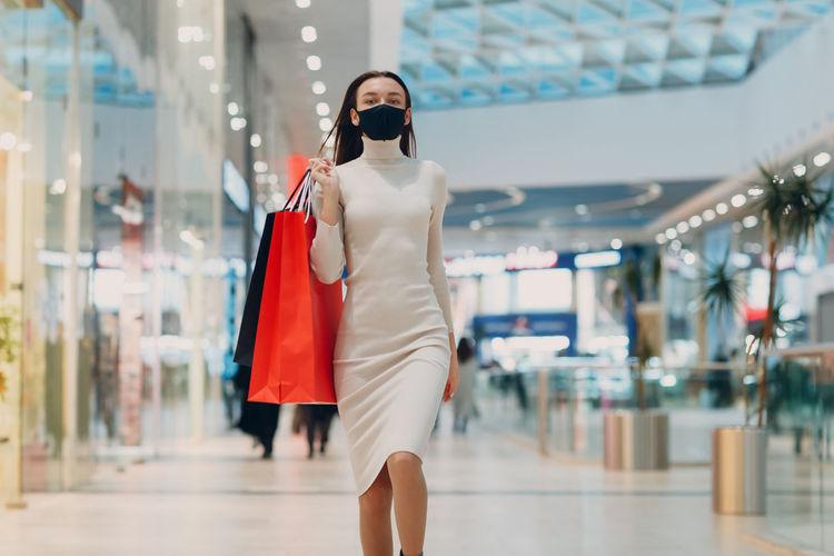 Full length of woman walking in store