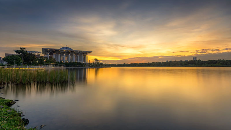 Sunset Mosque Lake Building Exterior Relegion Water Sky Clouds Travel Destinations Architecture Reflection History Sunset Tourism Water Outdoors Landscape Built Structure