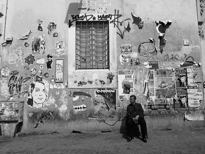 Rear view of woman with graffiti on wall