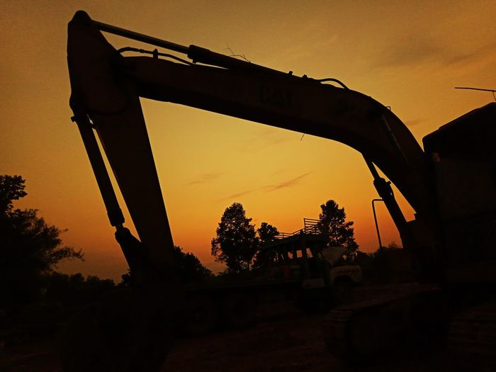 Silhouette backhoes in constuction site Construction Site Construction Site Backhoe Industry Industrial Working Worker Car Truck Land Silhouette Sun Sunset Tree Silhouette Sky Historic The Past Archaeology