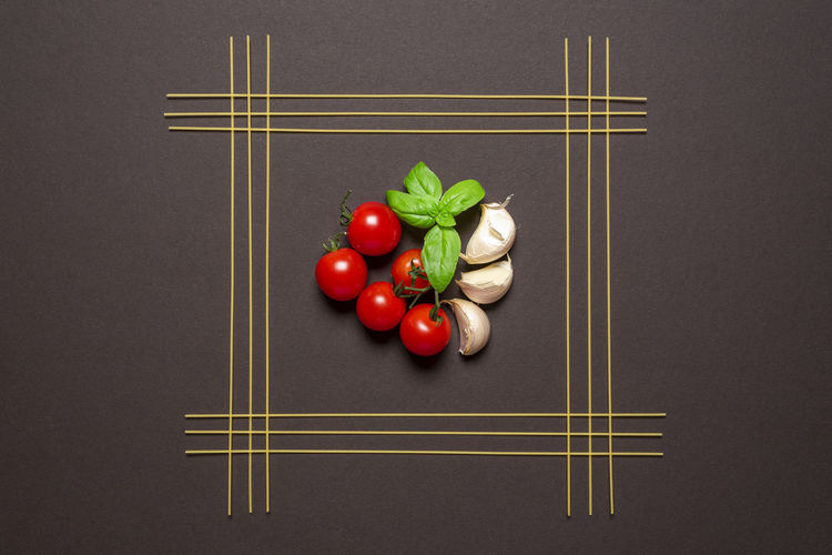 High angle view of tomatoes on table against black background