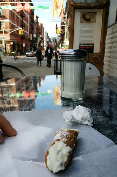 New York City may be the Big Apple but I like the cannoli. Food And Drink Building Exterior Food Snacks Outdoors Sidewalk Discoveries Little Italy Reflections Day EyeEm Best Shots The Street Photographer - 2017 EyeEm Awards