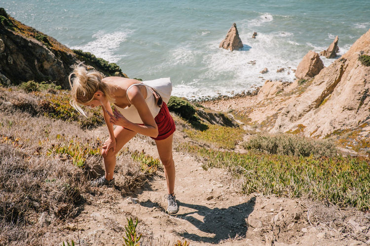 Hiking at Cabo da Roca with @annamaresa Beautiful Coastline Done That. EyeEm Nature Lover Hiking Rock The Week On EyeEm Travel Blue Climbing Coast Landscape Mountain Ocean People Photo Roadtrip Sea Sea And Sky Seaside Sky Travel Destinations Women Women Around The World Young Women