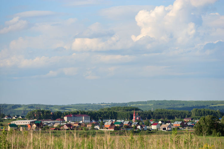 TOWNSCAPE Building Exterior Cloud - Sky Day Distant Horizon Distant View Environment Field Land Landscape Outdoors Scenics - Nature Siberia Sky Town View From Distance
