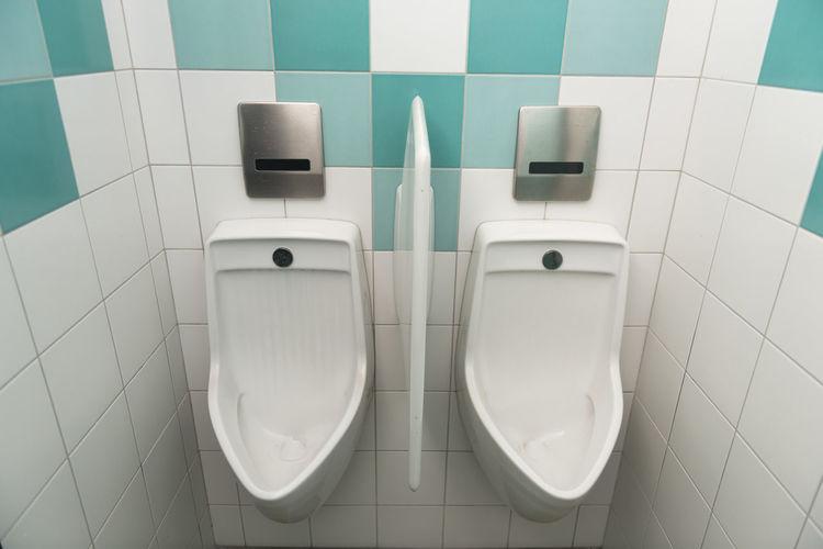 Urinals in public restroom