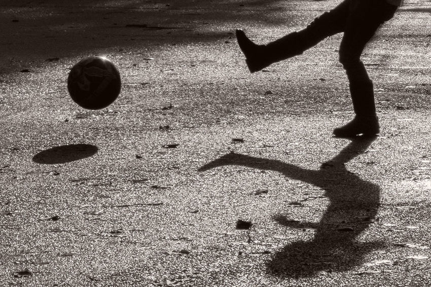 Playing football on a damp Winter's day in the park. Light And Shadow Black & White Moordown Dorset